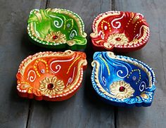 Oil Lamps Set of 4 Traditional Earthen Terracotta Diyas Candle Tea Light Holders Colorful Handpainted with Studded Stones Home Festive Decorations *** Visit the image link more details. Diwali Diya, Diwali Craft, Diy Diwali Decorations, Festival Decorations, Marriage Decoration, Arts And Crafts, Diy Crafts, Stone Houses, Lamp Sets