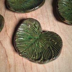 2 coats of Seaweed over 1 coat of Temmoku on Cinco Rojo clay fired to cone 5 by Amanda Joy Wells of Sublime Signs Studio