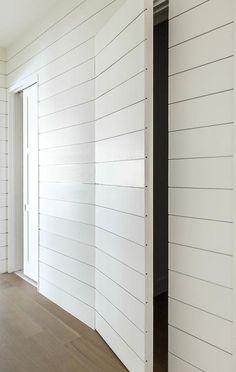White shiplap hallway walls help to conceal a powder room behind a white shiplap jib door. Hallway Closet, Hallway Walls, Closet Doors, Hidden Doors In Walls, Hidden Rooms, Invisible Doors, Hidden Closet, White Shiplap Wall, Bathroom Doors