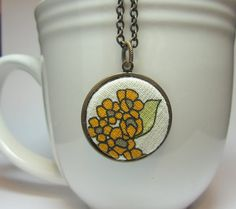 Yellow Flowers Fabric Pendant Necklace.  So cute! #jlrdesigns #etsy