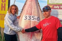 Eagle Scout Jackson Hobbs, left, is congratulated by skipper Travis Larson for the huge halibut he caught. Photo by Nyle Nightcap/Homer Chamber of Commerce