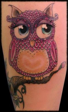 Owl tattoo.  Love the eyes!
