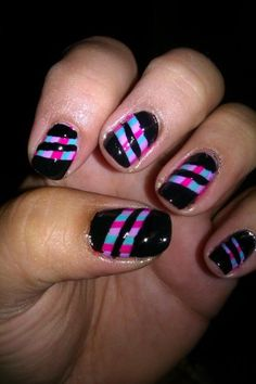 paint designs on nails, dry, put stripes of tape over, paint back over, rip off tape. sooo cool!