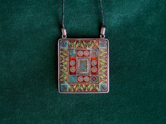 This is a cloisonne enamel necklace