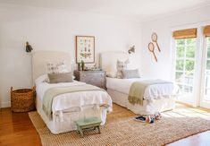 bright farmhouse bedroom with twin kids beds