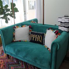 Add some color to your office space by getting some colorful furniture! It brightens up the office and let's be real, it just looks really cute! Add some decorative throw pillows, and you got yourself an adorable little lounge area!