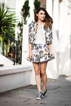 Anisa Sojka wearing Keepsake The Label white sequin beautiful liar skirt and bomber jacket, ASOS white camisole top and black and white Converse Chuck Norris trainers. Fashion blogger street style shot in London by Cristiana Malcica.