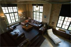 exposed brick. warehouse windows. industrial lighting. modern furniture. perfect. #modern #architecture #home