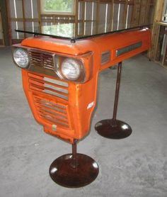 This Kubota vintage tractor was rescued and magnificently re-purposed into a table bar with an quality glass top. This unique design is for the individual who is not into the mass-produced look and wants to ensure that there is nothing common about any of their home furnishings. Perfect for a man-cave too!