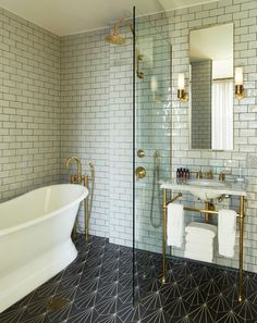 I love this modern bathroom in The Williamsburg Hotel in New York. Metro/subway tiles, patterned floor tiles and brass bathroom details and that bath! Bathroom interior goals right there.
