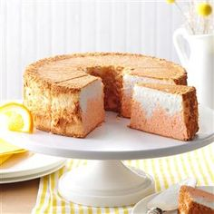 Orange Dream Angel Food Cake Recipe -A basic angel food cake becomes a heavenly indulgence thanks to a hint of orange flavor swirled into every bite. The orange color makes slices of the cake look so pretty when arranged on individual dessert plates.—Lauren Osborne, Holtwood, Pennsylvania