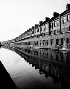 London - Grand Union canal, Paddington branch, Bill Brandt These buildings still exist and are on the Harrow Road. The longest canal barge route in Britain built to ship coal etc. from place to place. In conjunction with the goods railway carriage. Man Ray, Building Photography, City Photography, Landscape Photography, Bill Brandt Photography, Reflection Photography, Minimalism Living, High Contrast Images, Robert Frank