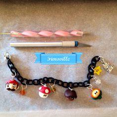 Bracciale a tema super Mario con charms realizzati a mano e perle in vetro sfaccettate