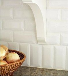 Simple vertical relief pattern adds a catching detail to standard subway wall tile layout.