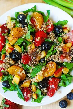 Quinoa salad with spinach, strawberries, blueberries, peaches, and mandarin oranges - a vibrant Summer salad that features lots of berries and fruit! The salad is tossed in a Balsamic vinaigrette dressing made from scratch using Quinoa Fruit Salad, Spinach Salad, Quinoa Spinach, Orange Quinoa Salad, Fruit Salads, Salad With Fruit, Fresh Fruit, Berry Salad, Vegetarian Recipes