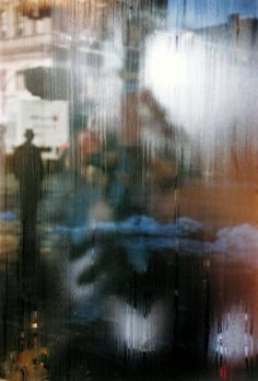 Saul Leiter.  One of the first photographers to use color.