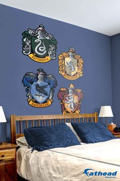 Fathead's removable vinyl wall decals, are so much easier to put up than wallpaper because you just peel it off the sheet and stick it on the wall — no tape, tacks or putty required. SHOP wall graphics at http://www.fathead.com/entertainment/harry-potter/hogwarts-house-sigils-wall-decals/ | DIY Kids Fun Bedroom Decor Ideas | Boys + Girls Bedroom Wall Art Decor