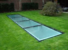 Walk on Rooflight, incorporated in a green roof