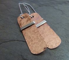 Copper and Silver Earrings. Recycled Copper by phoenixmtncreations, $34.54   Hand forged copper earrings made from reclaimed copper pipe. The copper pipe has been cut then hand formed and hammered to create a great textured look.