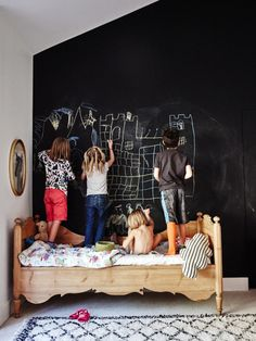 On encouraging kids' hobbies: I try to keep my kids' interests in mind when making decor decisions. My daughter loves to draw, so I made this entire wall a chalkboard wall. That way, she can draw to her heart's content!