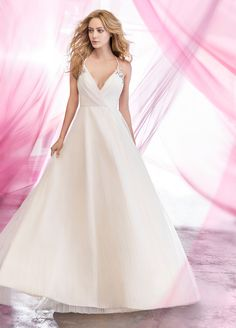 CosmosIvory pleated net A-line bridal gown, draped V-neck bodice with delicate straps and beaded applique, full pleated skirt.