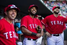 Texas Rangers shortstop Elvis Andrus (1), center, and Texas Rangers first baseman Mitch Moreland (18), right, and other players look up at the score board before their game against the Tampa Bay Rays on Friday, August 14, 2015 Globe Life Stadium in Arlington, Texas. (Ashley Landis/The Dallas Morning News)