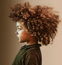 -serious-mixed-race-boy-with-curly-hair