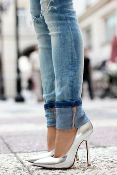 blue ripped jeans and silver metallic high heels shoes