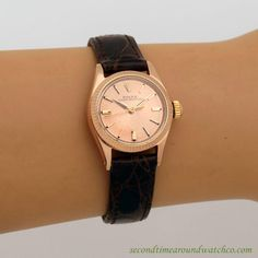 1960's Vintage Rolex Ladies Oyster Perpetual Ref. 6619 18k Rose Gold watch with Original Salmon Dial with Applied Rose color Stick/Bar/Baton Markers. Triple Sig