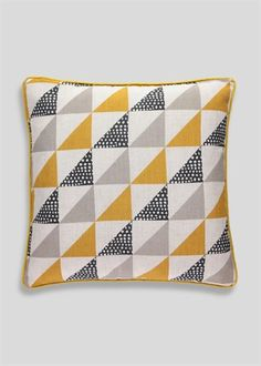 Tribal cushion with large triangle print design in yellow, grey and cream. Features yellow piping and plain yellow reverse. Part of the Tribal trend.