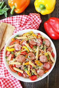 Spicy Sausage and Pepper Pasta Recipe on twopeasandtheirpod.com You can have this colorful pasta dish on your table in 30 minutes! #pasta