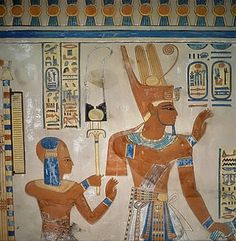 Egyptian wall painting in the tomb of Amen-hor-khepeshef. The son of Ramses III wearing the side-lock of youth stands behind the pharaoh.