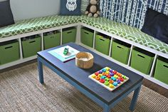 built-in corner seating with cubbie storage.  Places to stretch out and read a book, storage, and a table for play or snacks.