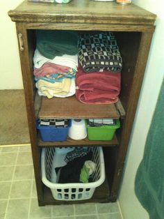 """Upcycled entertainment center,cut off half with shelves and viola,bathroom helper - This is not a """"magazine quality"""" image but you get the picture."""