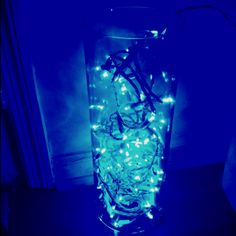 Blue LED Christmas lights in a long clear glass vase!