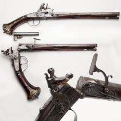Italian Breechloading Pistol - In a world of muzzleloaders, the person that had this break-open snaphance would have had an advantage with a handgun that could be reloaded quickly with preloaded chambers, about as fast as today's Thompson-Center Contender single-shot pistol. The removable chambers were fitted with a sliding pan that as the pistol closed, opened for firing. Talk about quick and fast shooting, just change chambers and cock the hammer. NRA National Firearms Museum in Fairfax…