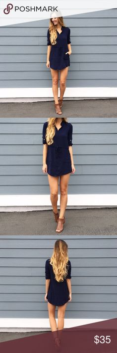 | new | navy tunic/dress offers welcome new with tag semi sheer navy unlined tunic with roll tab sleeves and tied elastic waist. could be worn as a dress for shorter heights. modeling size small. •681098• Dresses Long Sleeve