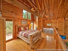 Open-plan loft large enough for a king bed supplements the master bedroom - nice area to hang for people sharing the cabin