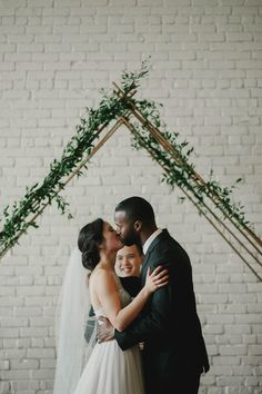 Cute kisses from this minimalist wedding ceremony at One Eleven East | Image by Geoff Duncan