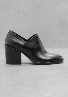 Creamy leather with light shine shapes these low-cut ankle boots elevated with a comfortable block heel.