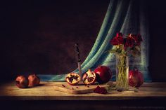 Davide Solurghi Photography - Recent Work - Punica granatum | Thank you so much for the visits, favs and comments :)  ©Davide Solurghi All Rights Reserved #stilllife #indoor #inside #studio #Flowers #wood #table #pomegranate #backdrop #wooden #furniture #earthenware #nature_morte #natura_morta #food #cibo #fiori #granatum #punicagranatum