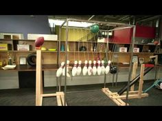 The SportsNation Rube Goldberg Machine - YouTube - SportsNation celebrated 2 million Facebook fans by creating this Rube Goldberg machine in the office!