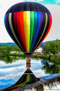 some color for a gloomy day! the reflection makes the balloon look like it melting into the water and spreading out it's colors.