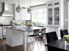 white kitchen, marble backsplash, gray walls, and hicks pendant fixtures by Thomas O'brien.