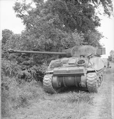 Sherman Firefly June 1944, France. German Anti-tank crews were trained to fire and focus their fire first on Armored command vehicles and the larger calibre Firefly to knock them out early.