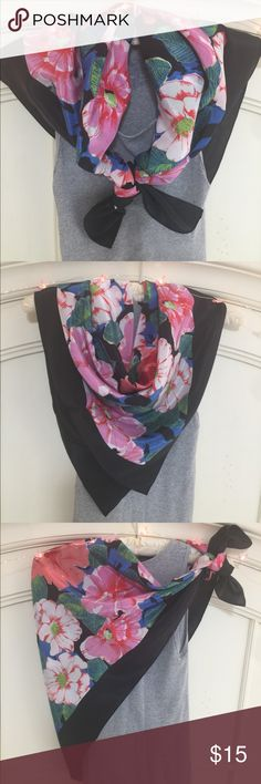 Black framed floral print scarf Floral print scarf has black frame with tropical floral print flowers in pink/lavender, peach, red with outline of green leaves. Rich blue and black make up the background. This scarf feels, looks and flows like silk, but is made from polyester. This scarf measures 33 inches by 33 inches Accessories Scarves & Wraps