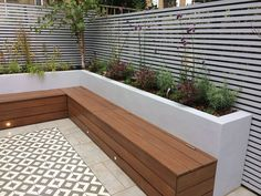 Garden seating - Custom hardwood seat with storage Timber trellis screens Perennial feature planting, Silver birch courtyard tree Construction by Germinate Gardens Garden seating, Backyard landscaping Backyard Seating, Small Backyard Landscaping, Backyard Garden Design, Small Garden Design, Backyard Patio, Diy Garden Seating, Built In Garden Seating, Courtyard Landscaping, Contemporary Garden Design