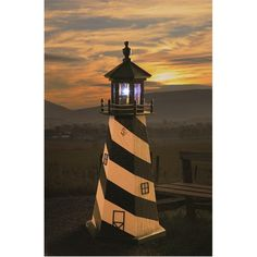 Amish-Made Cape Hatteras Wooden Garden Lighthouse (120 CAD) ❤ liked on Polyvore featuring home, outdoors, outdoor decor, garden patio decor, outdoor patio decor, solar powered garden decor, solar garden decor and garden decor