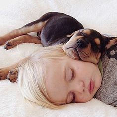 Mother Instagrams Adorable Pics of Baby Boy Sleeping With Adopted Puppy