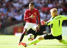 After a mazy run, Jesse Lingard of Manchester United scores his sides first goal past Kasper…